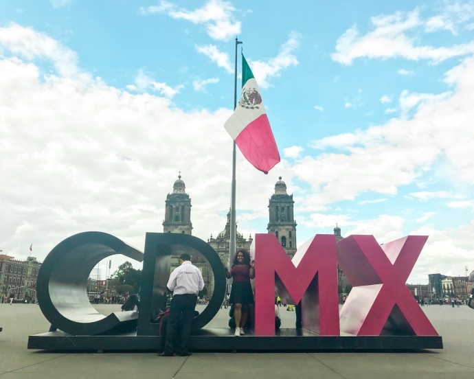 CDMX Sign, in the background the Mexican flag in the Zocalo in Mexico City, MX